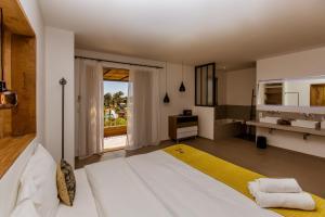 Un ou plusieurs lits dans un hébergement de l'établissement Hotel Les Chambres de Mila
