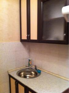 A kitchen or kitchenette at Apartments