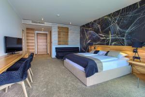 A bed or beds in a room at Hotel Villa Margaret