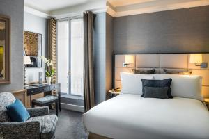 A bed or beds in a room at Sofitel Paris Baltimore Tour Eiffel
