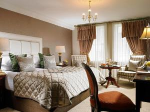 A bed or beds in a room at Muckross Park Hotel & Spa