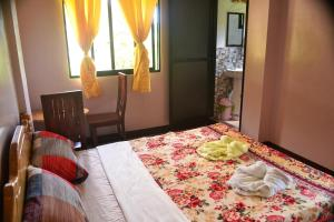 A bed or beds in a room at Banaue Greenfields Inn