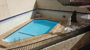The swimming pool at or near Apartamento Atalaia Aracaju