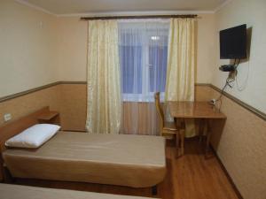 Ein Bett oder Betten in einem Zimmer der Unterkunft Dom 18
