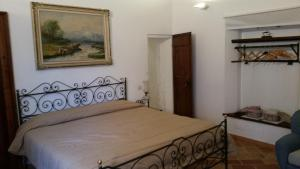 A bed or beds in a room at Pigiotto