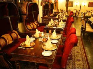 A restaurant or other place to eat at Arabian Courtyard Hotel & Spa
