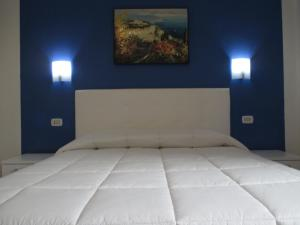 """A bed or beds in a room at Palinuro casa vacanze """"Donna Antonia"""""""