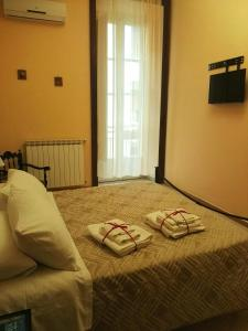 A bed or beds in a room at Domus Cicerone