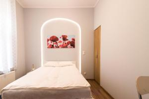 Łóżko lub łóżka w pokoju w obiekcie Sopot Host Patio