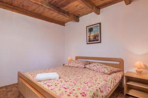 Кровать или кровати в номере Apartmani Žiković