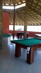 A pool table at Casa em Cabo Frio