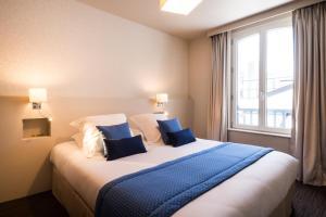 A bed or beds in a room at Villa Odette