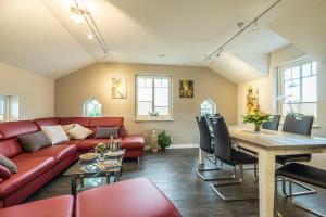 Ein Sitzbereich in der Unterkunft Villa Scandic Apartments