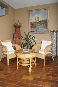 Ein Sitzbereich in der Unterkunft Gästehaus zur Mühle Dehm