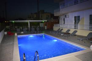 The swimming pool at or near Kremasti Memories
