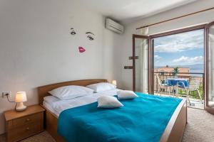Postel nebo postele na pokoji v ubytování Apartmani Bezma