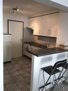 A kitchen or kitchenette at HOLLYWOOD12