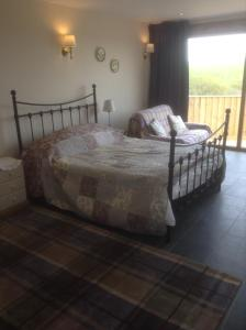 A bed or beds in a room at Frankaborough Farm Holiday Cottages