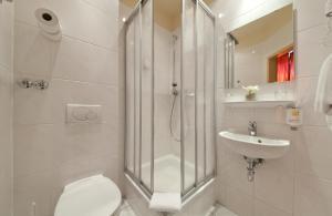 Ein Badezimmer in der Unterkunft Hotel Polo am ZOB