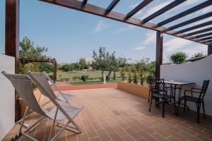 A balcony or terrace at Quinta dos Poetas Nature Hotel & Apartments