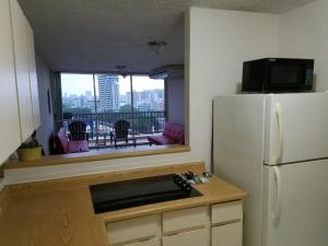 A kitchen or kitchenette at San Juan City View Penthouse