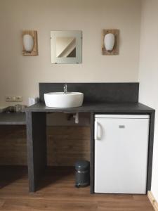 Een badkamer bij Herberg de Zwaan Hedel