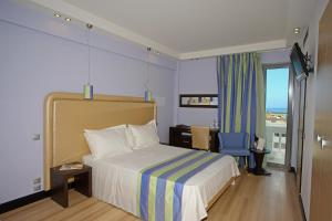 A bed or beds in a room at Olympic Palladium
