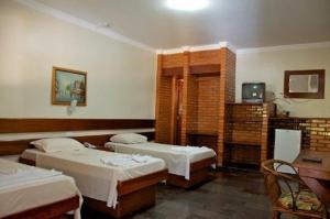 Cama ou camas em um quarto em Hotel Master