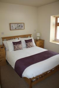 A bed or beds in a room at Charnock Farm Motel
