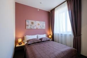 A bed or beds in a room at Hotel Galereya