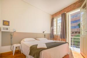 A bed or beds in a room at Brick Hostel