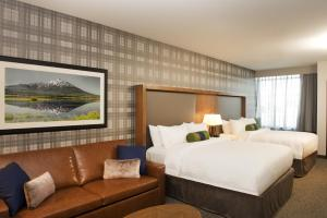 A bed or beds in a room at SpringHill Suites by Marriott Bend