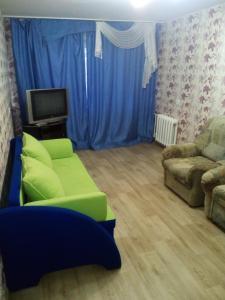 A seating area at Апартамент Нефтяник