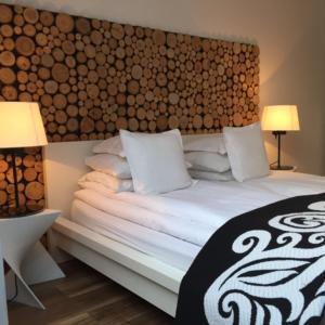 Łóżko lub łóżka w pokoju w obiekcie Kamienica Nadmorska