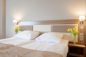 Łóżko lub łóżka w pokoju w obiekcie Hotel Diament Ustroń
