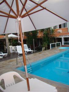 The swimming pool at or close to Hotel Enseada Itapema