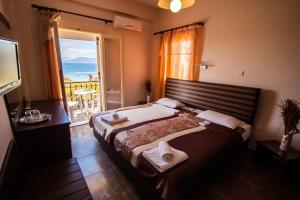 Ένα ή περισσότερα κρεβάτια σε δωμάτιο στο Ulrika