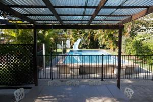 The swimming pool at or near Ron's Beach House