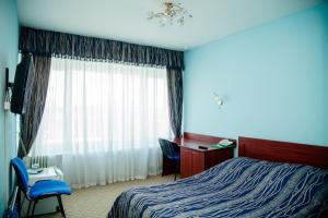 Кровать или кровати в номере Гостиница Татарстан Казань