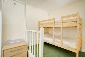 A bunk bed or bunk beds in a room at Woodbrooke