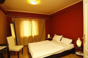 Ein Bett oder Betten in einem Zimmer der Unterkunft Die Dependance