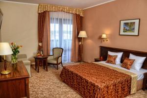 Кровать или кровати в номере Hotel Ventus Natural & Medical Spa