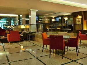 Um restaurante ou outro lugar para comer em TURIM Iberia Hotel