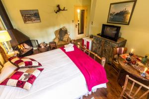 Cama ou camas em um quarto em Pousada Volta ao Mundo