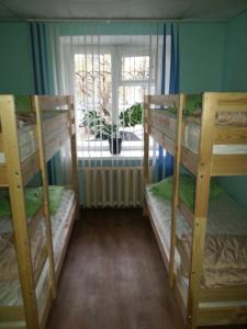 A bunk bed or bunk beds in a room at Hostel Ural Rover on Krylova