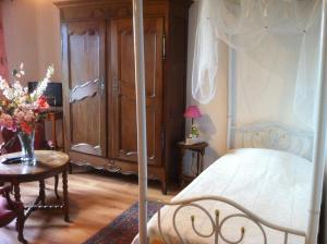 A bed or beds in a room at Ferme du Montheu