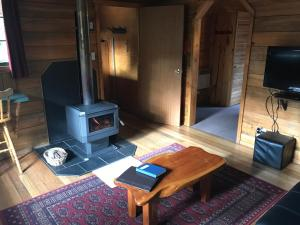 A television and/or entertainment centre at Cradle Mountain Highlanders