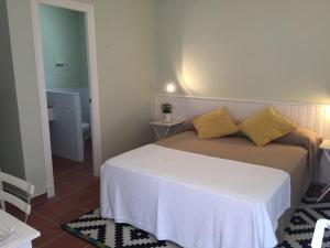 Cama o camas de una habitación en La Carmela Rooms