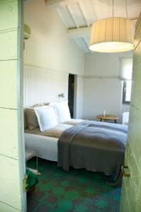 A bed or beds in a room at Il Ghiottone Umbro