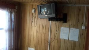 A television and/or entertainment centre at Sinilga MiniHotel
